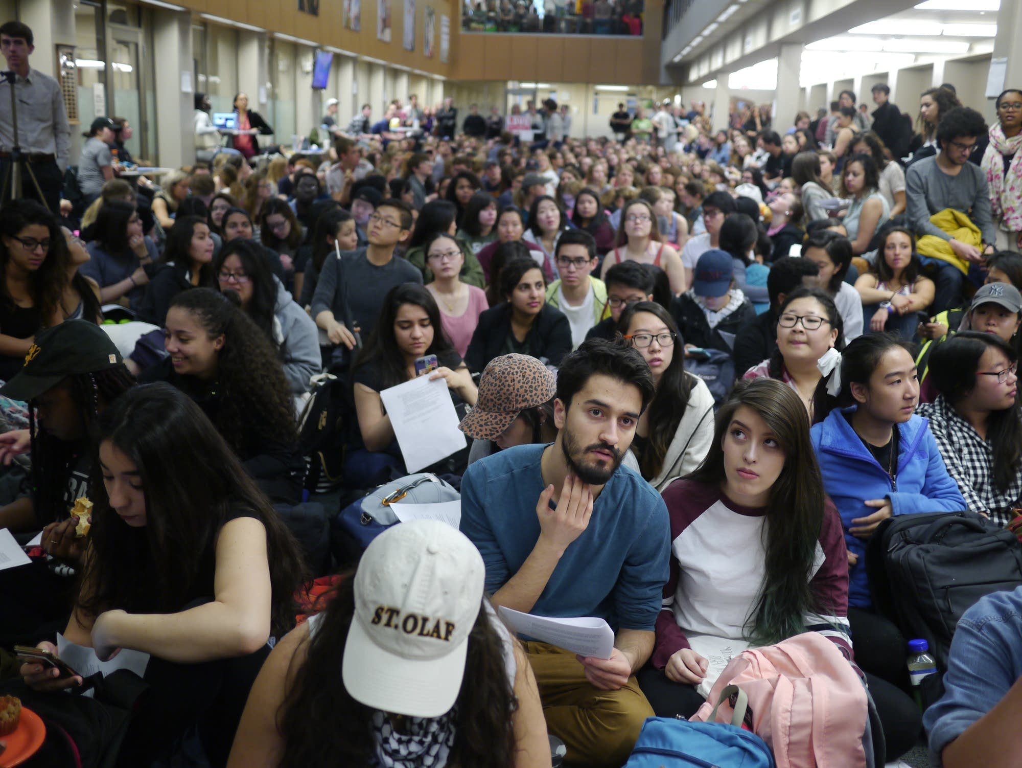 Students pack the atrium of the school's admin building