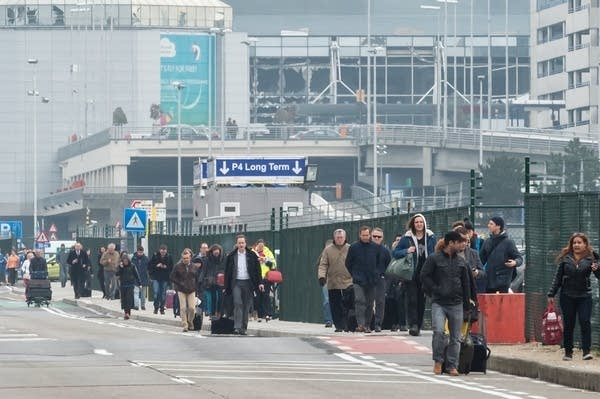 People walk away from the Brussels airport