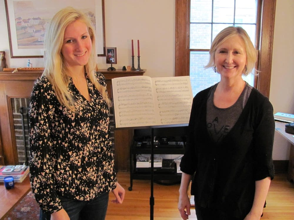 Flutist Wendy Williams, right, with a student