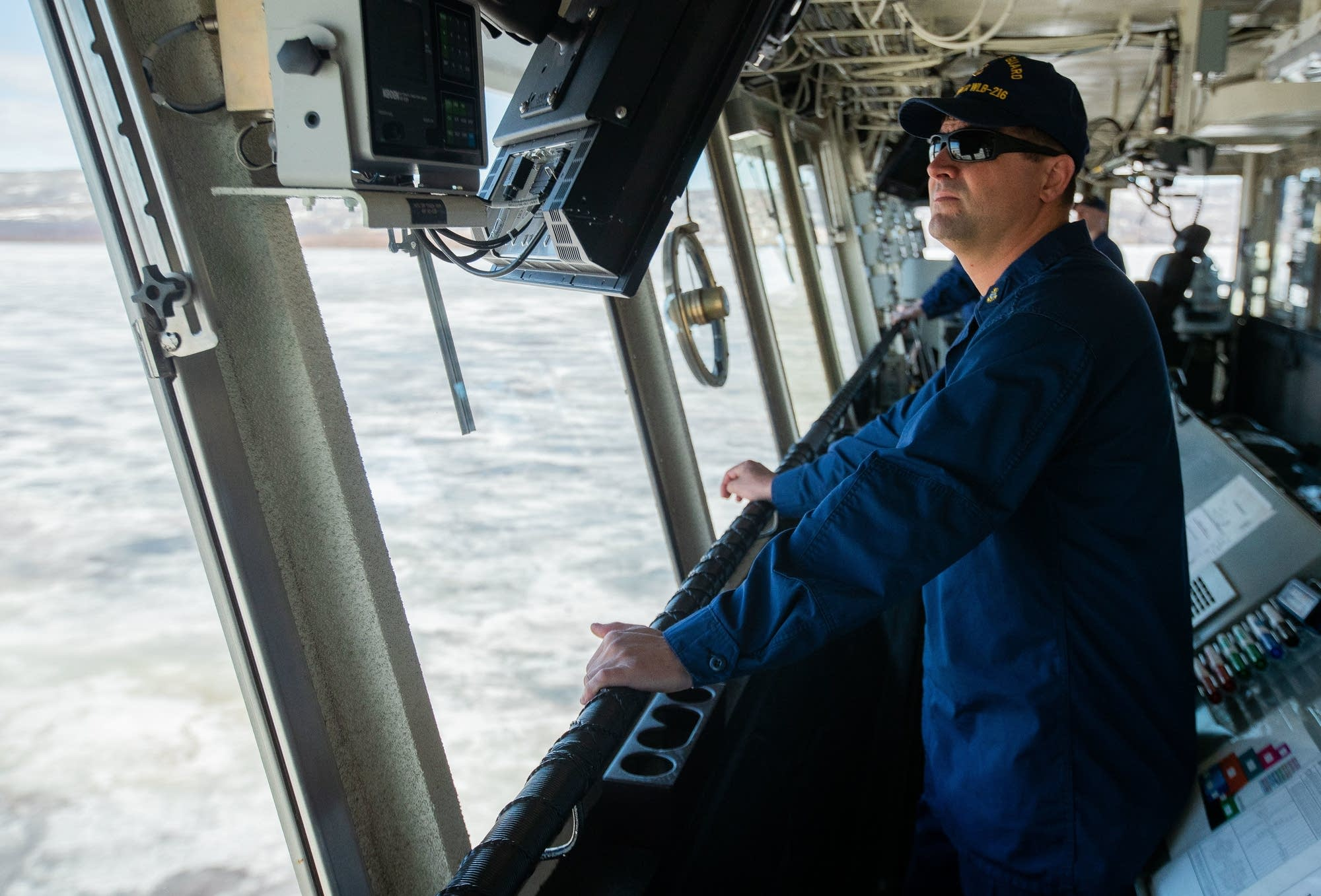 Chief Petty Officer Ben L'Allier directs navigation of the ice cutter.