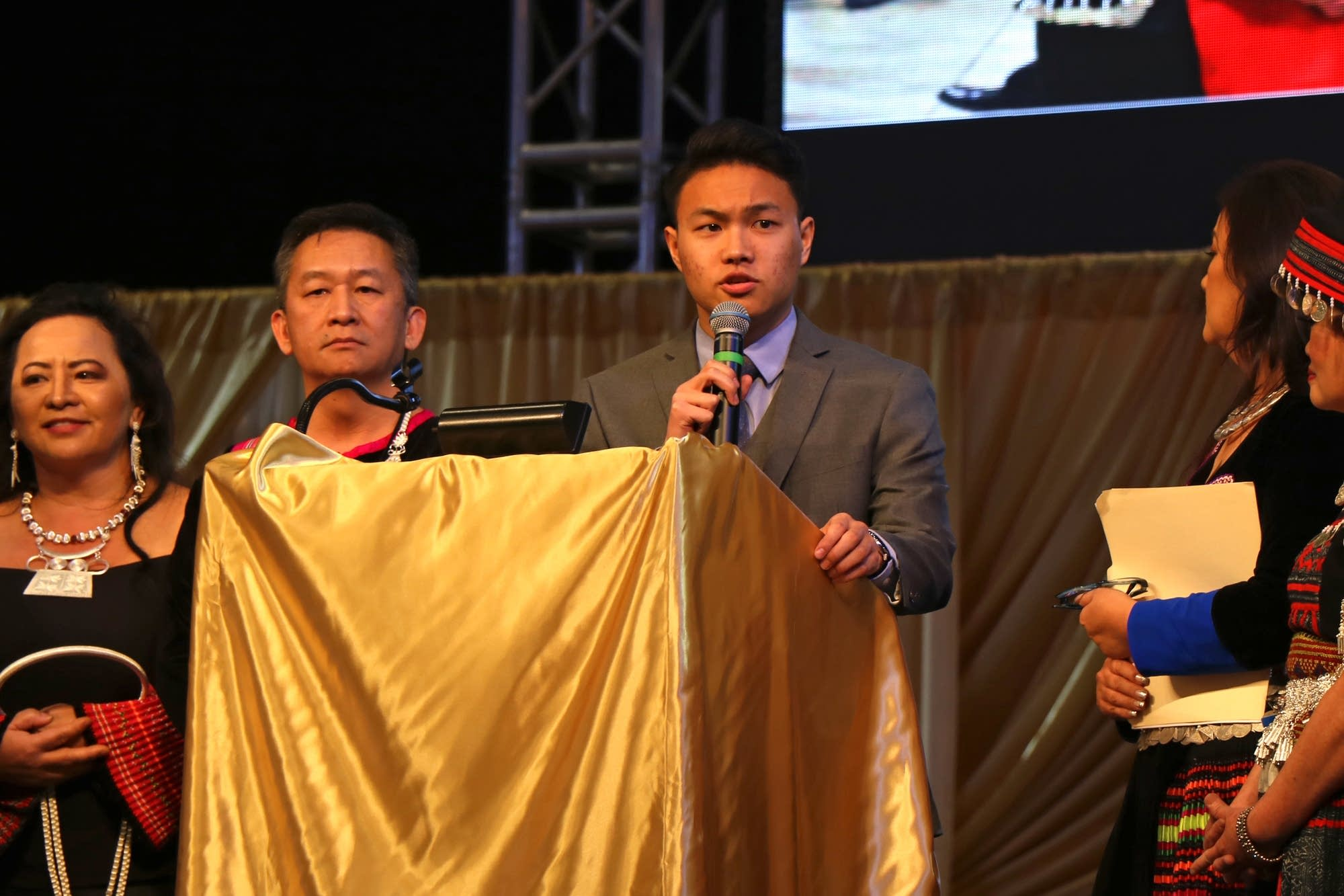 Leon Xiong, Winner Of The Hmong New Year Essay Contest, Recites His Essay.