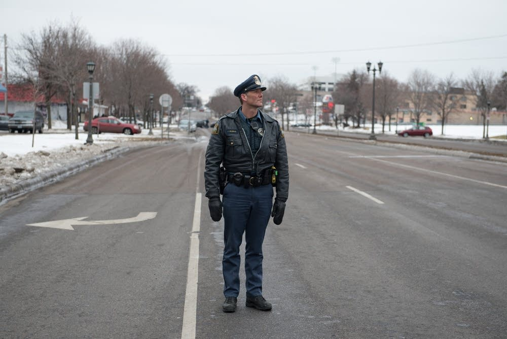 An officer stands at University and Lexington.