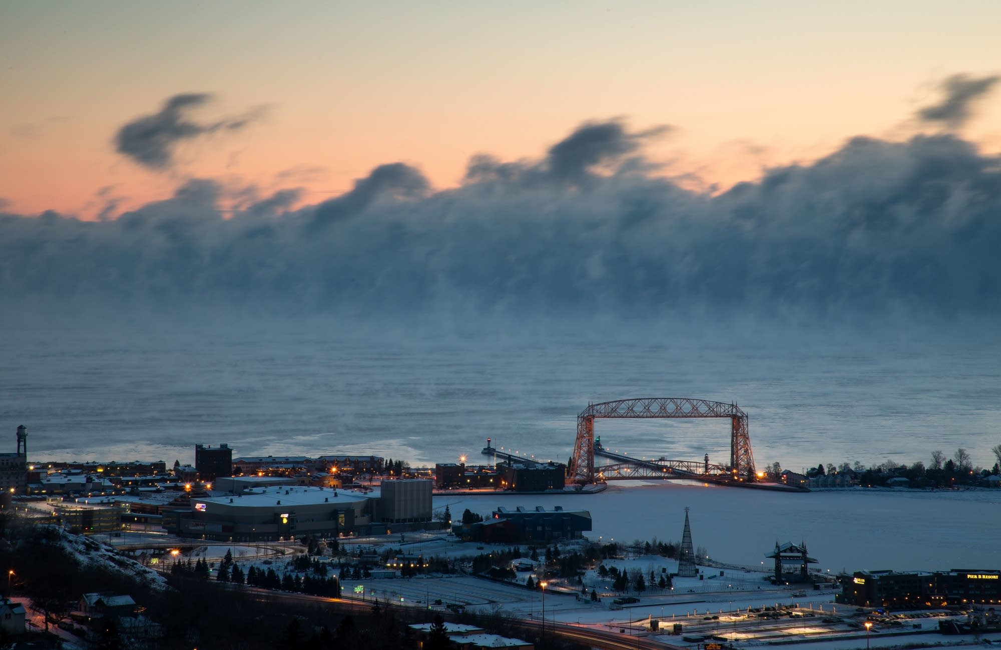 Sea smoke rises over Lake Superior and the Aerial Lift Bridge.