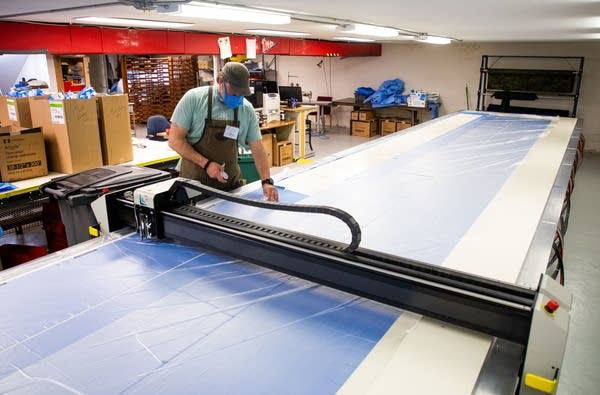 A man at a automated cutting table