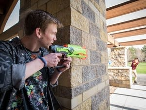 Jackson Odegard and Daniel Wong demonstrate how they play Nerf wars.