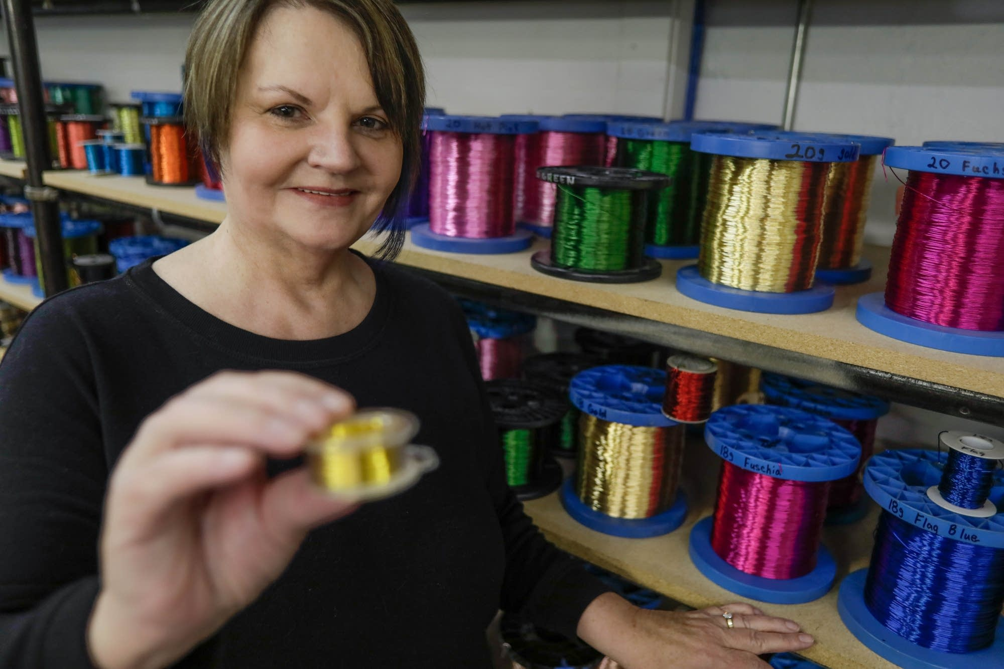 Edie Ramstad shows a six-ounce spool of wire.