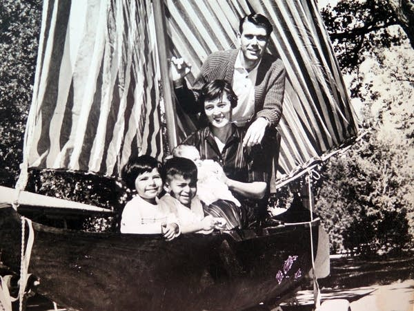 The Brooks family posed in a dugout canoe.