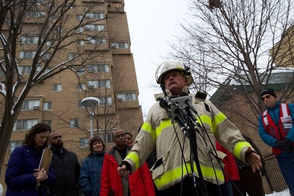 A fire official speaks at an outdoor news conference.