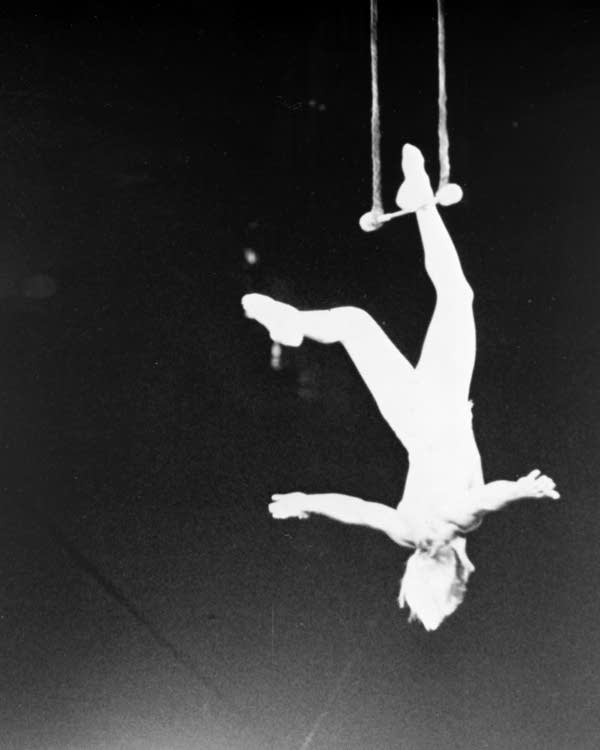 Dudley Riggs dangling from the trapeze in the early 1950s.