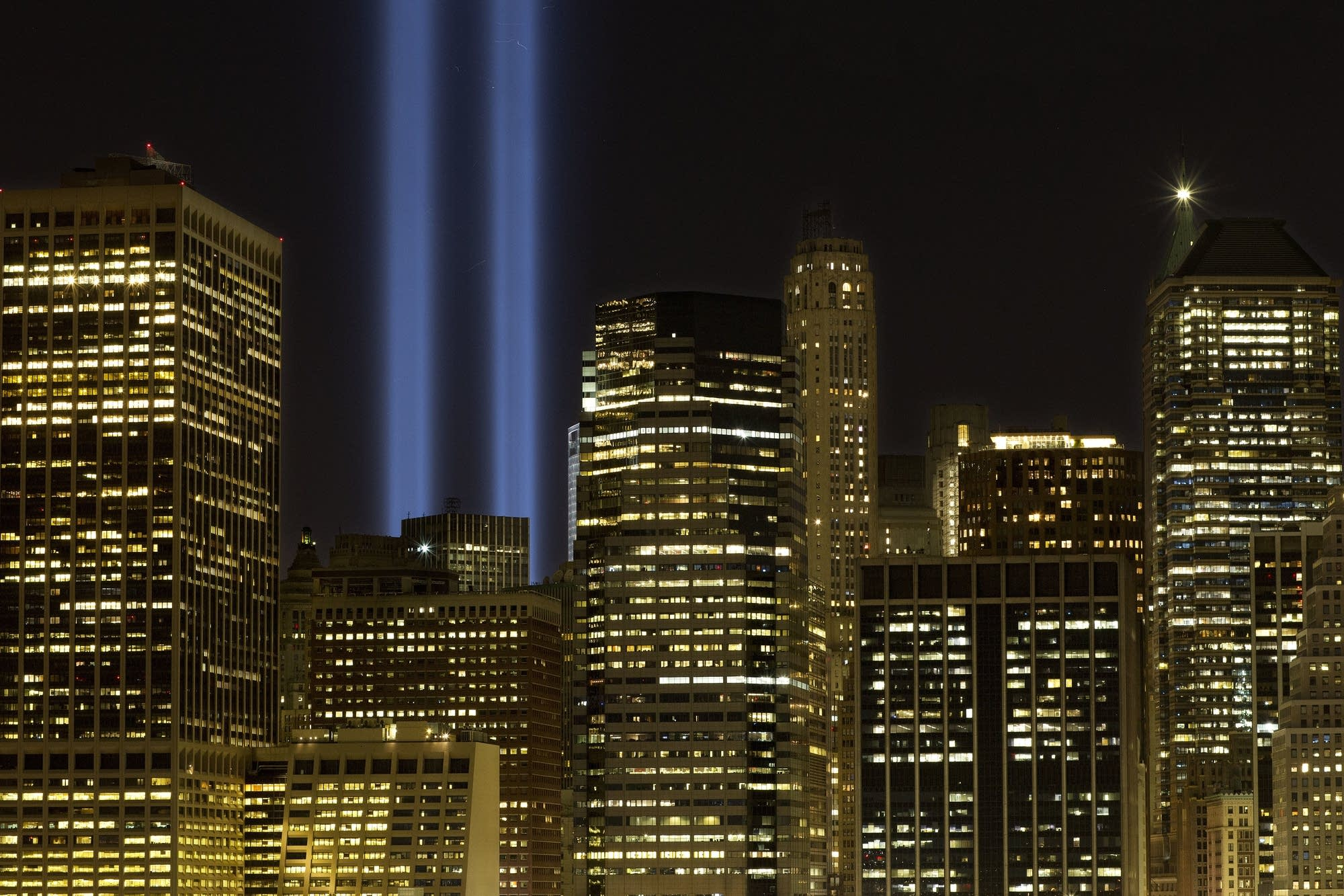 The Tribute in Light rises above the lower Manhattan skyline.