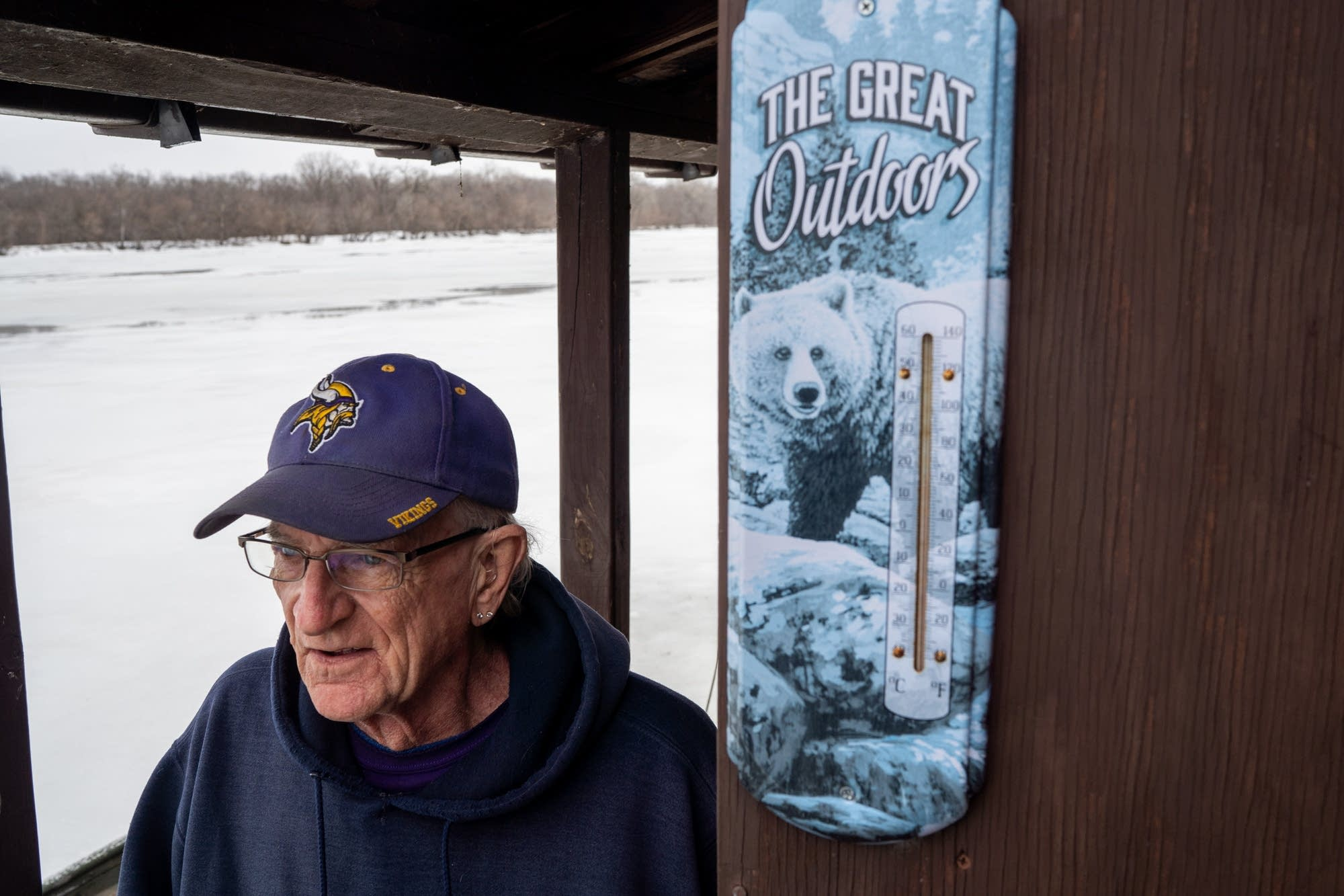 John Rupkey stands on the deck of his houseboat.