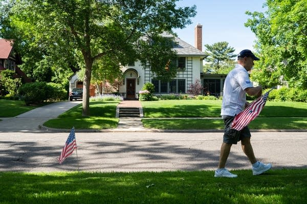 Tom Edelstein walks to the next spot where he'll plant a flag.