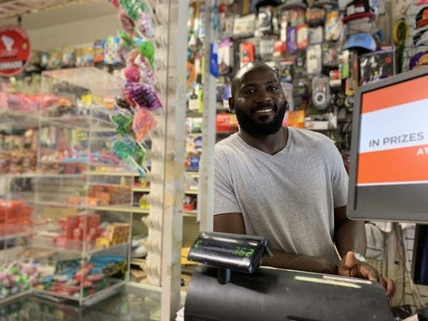 A man behind a store counter.