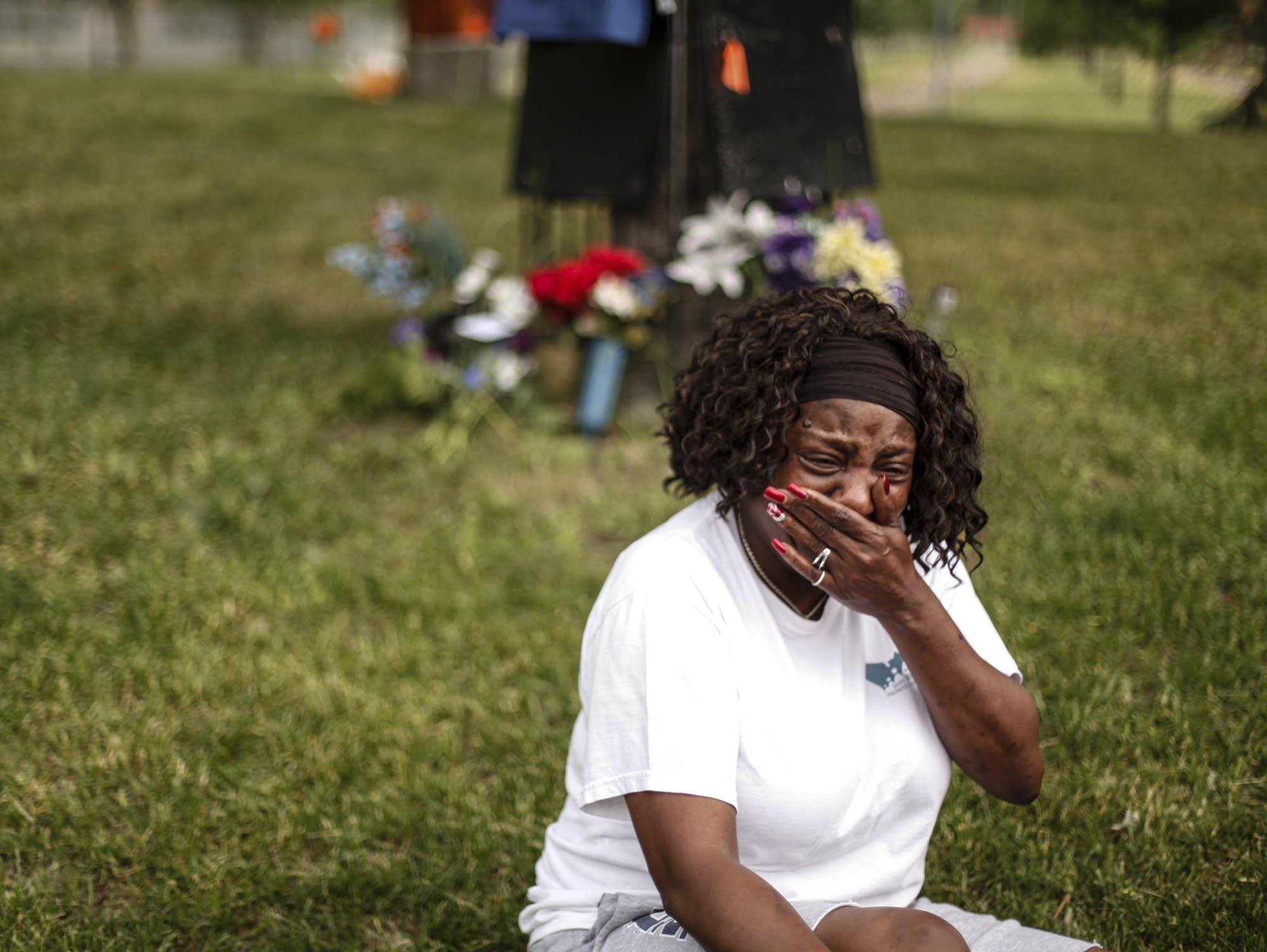Dora Jones mourns at the Castile memorial site