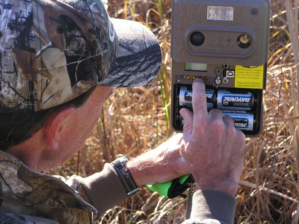 Bill Marchel and one of his trail cameras