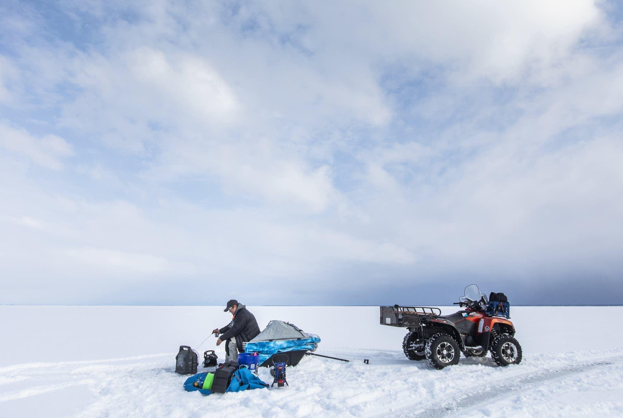 Rikki Pardun ice fishes on Lake Superior near Washburn Wis