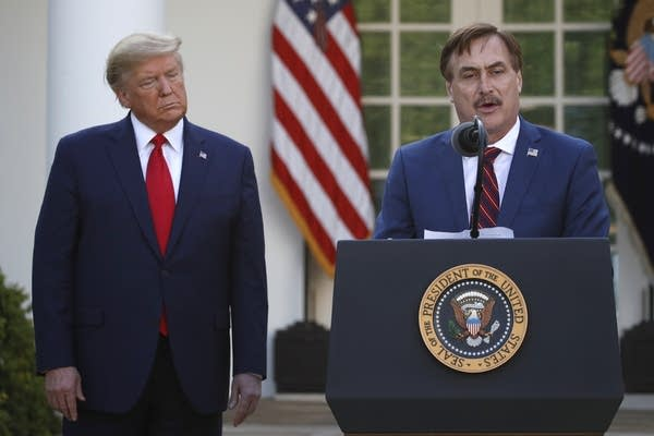 My Pillow CEO Mike Lindell speaks as President Donald Trump listens.