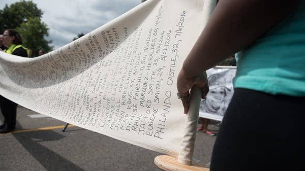 A banner lists people killed in Minnesota.