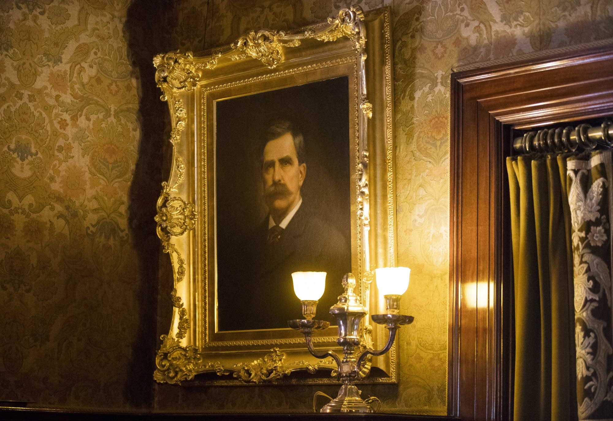 A portrait of Chester Congdon looks over visitors to the library.