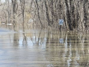 Water covers the main road in Ft. Snelling State Park.