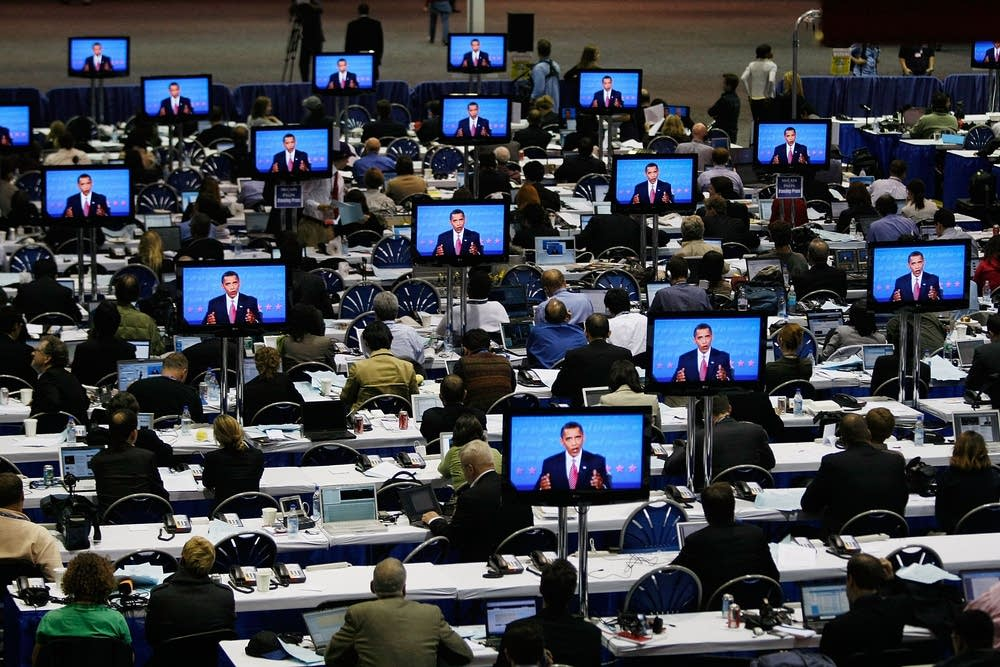 Monitors showing the final debate