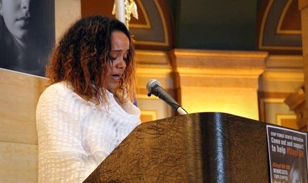 Netsanet Mengistu speaks against female genital mutilation at the capitol.