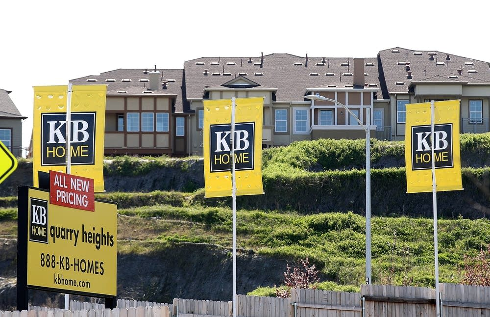 Signs are posted in front of new homes