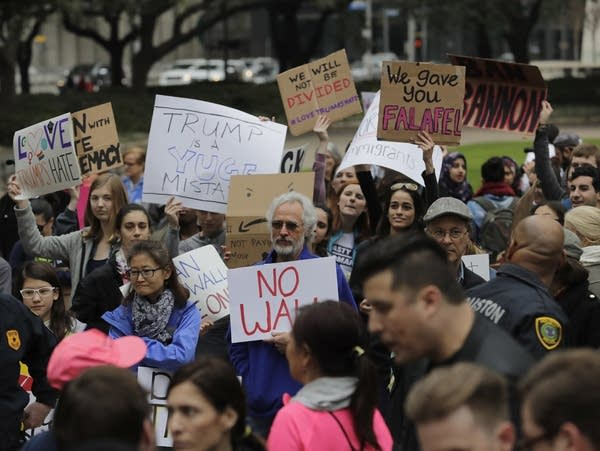 Protesters Demonstrate Against President Trump In Super Bowl Host City