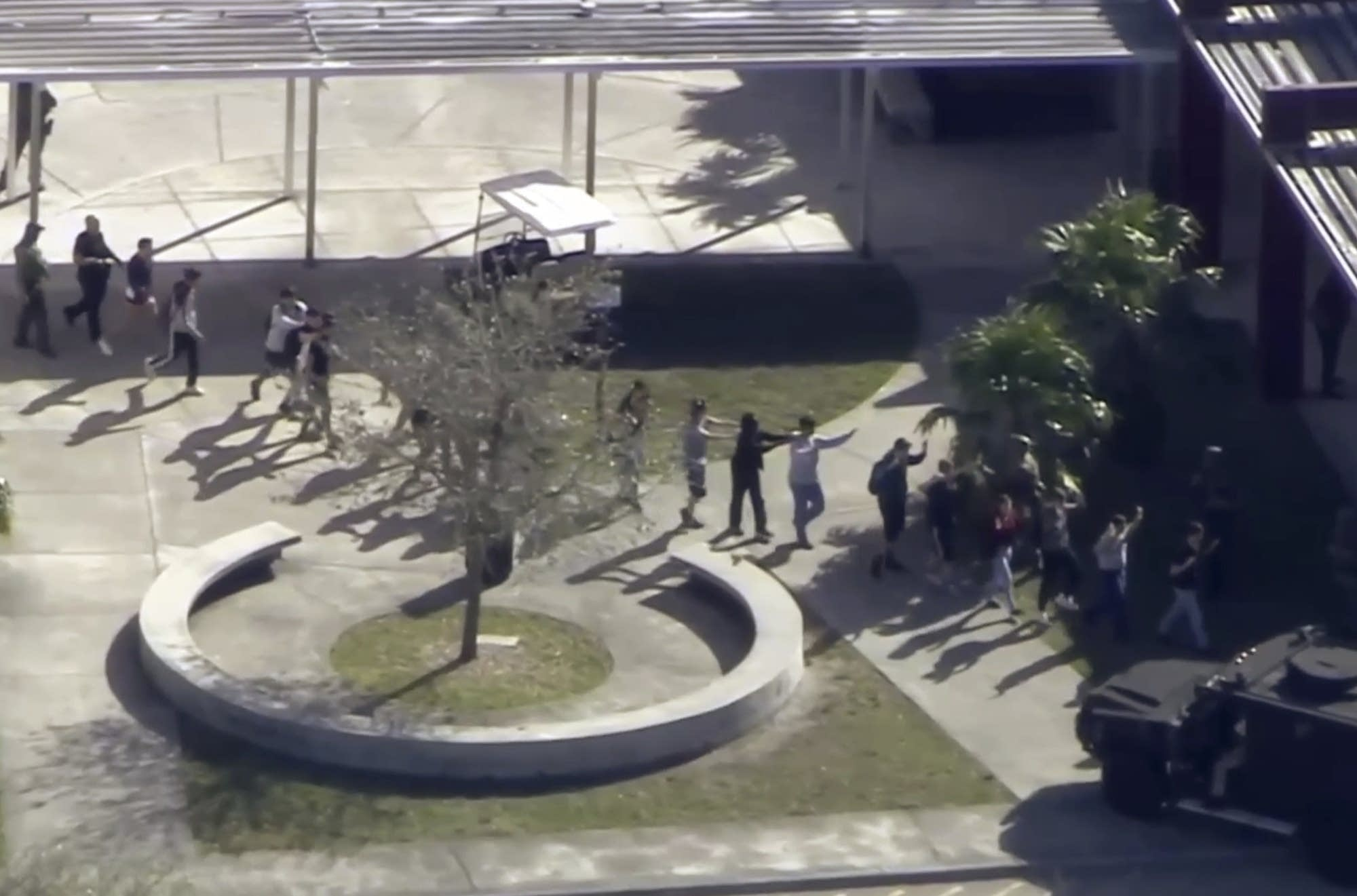 Students from the Marjory Stoneman Douglas High School evacuate.