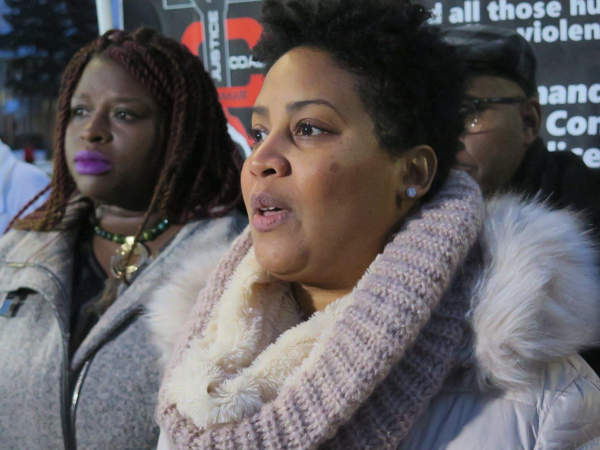 Raeisha Williams, right, whose brother Tyrone Williams was killed.