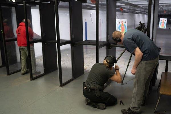 Fifteen-year member Tony Piekarski loads a gun.