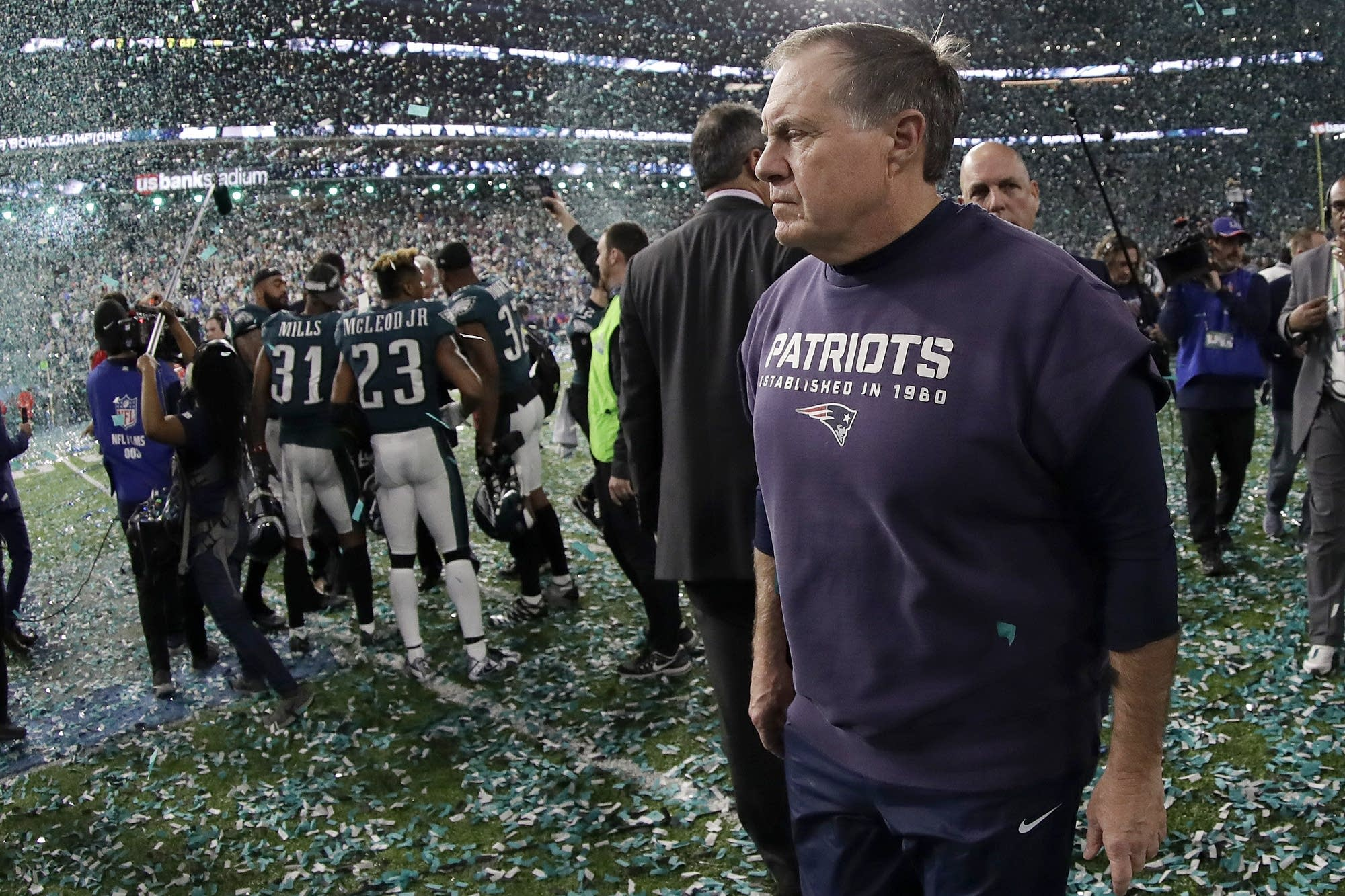 Patriots head coach Bill Belichick walks off the field.