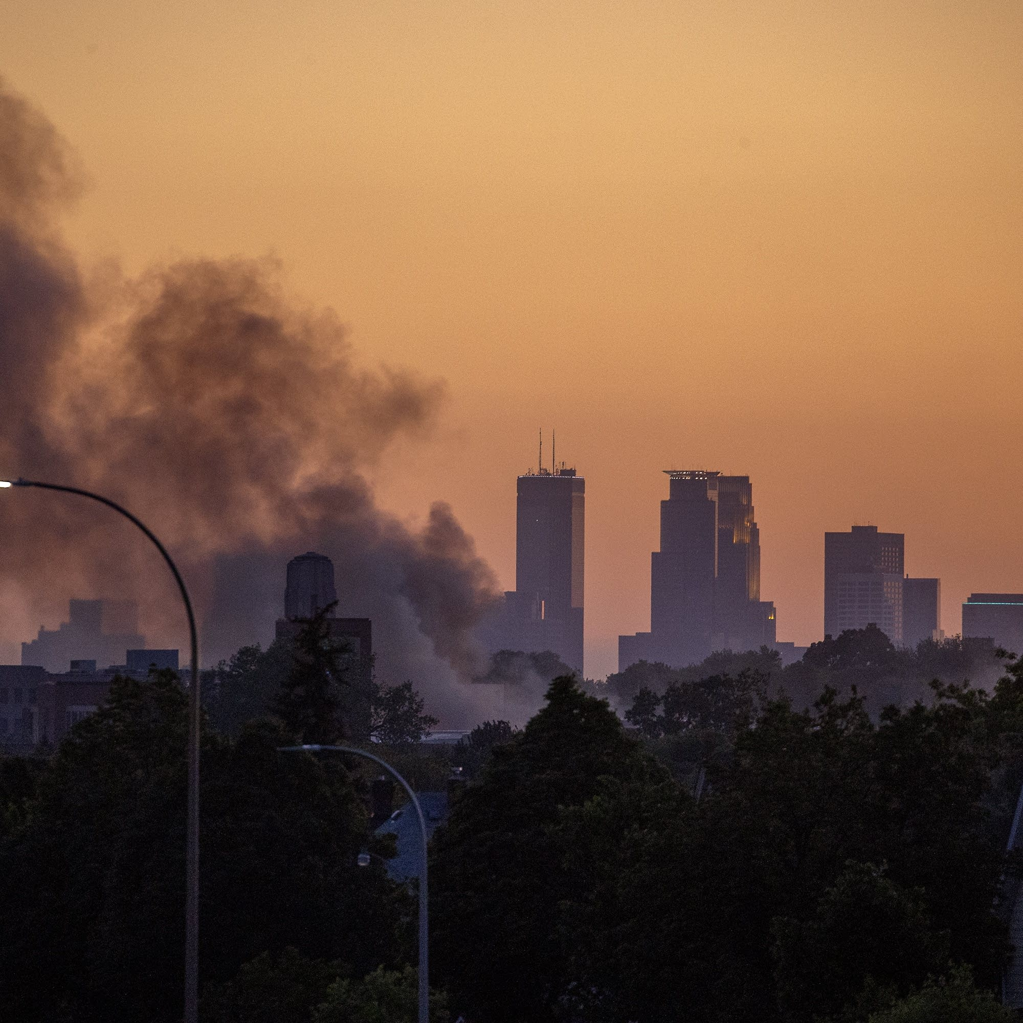 The sun set over the Twin Cities as smoke hovers over St. Paul