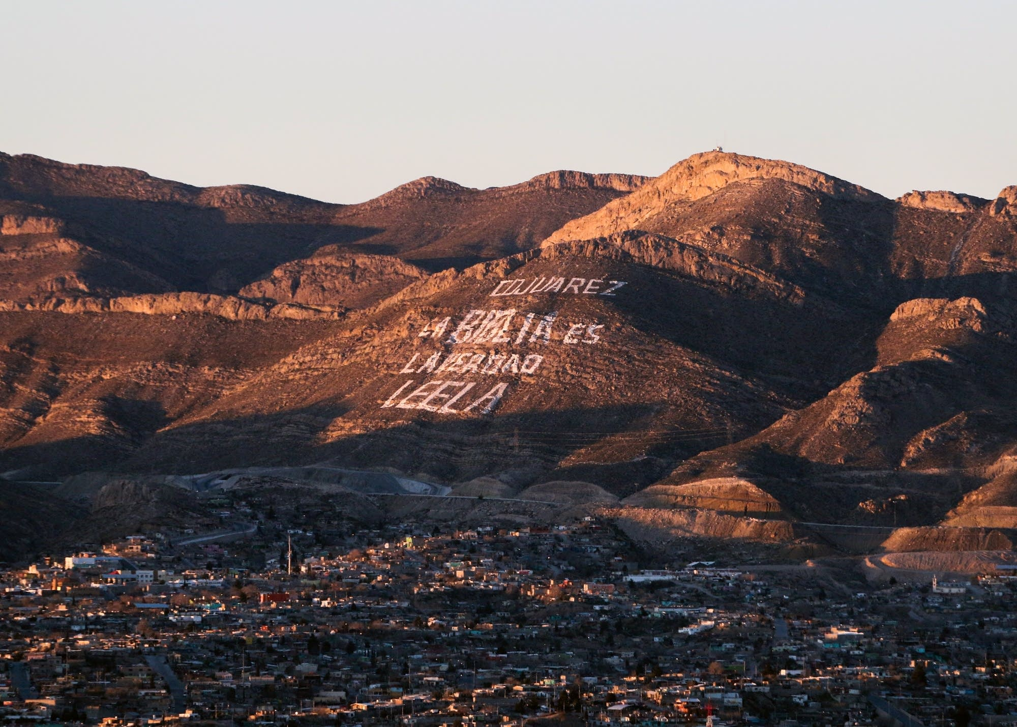 Message painted on a mountainside overlooking Ciudad Juarez, Mexico.