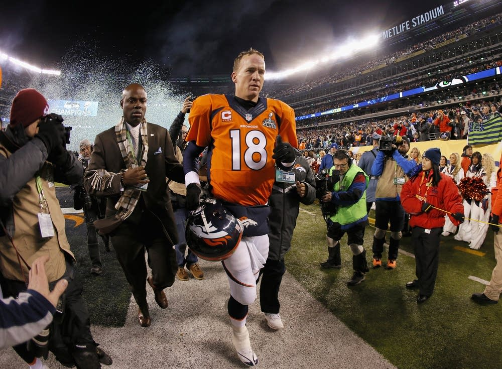Manning leaves the field