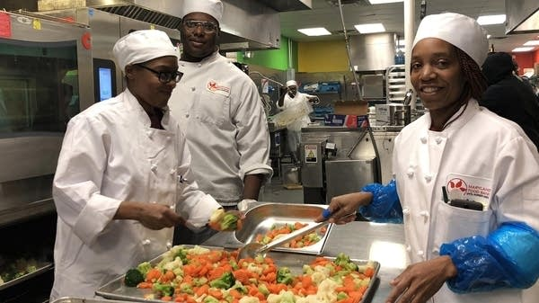 Students in the FoodWorks Program at the Maryland Food Bank prepare food.