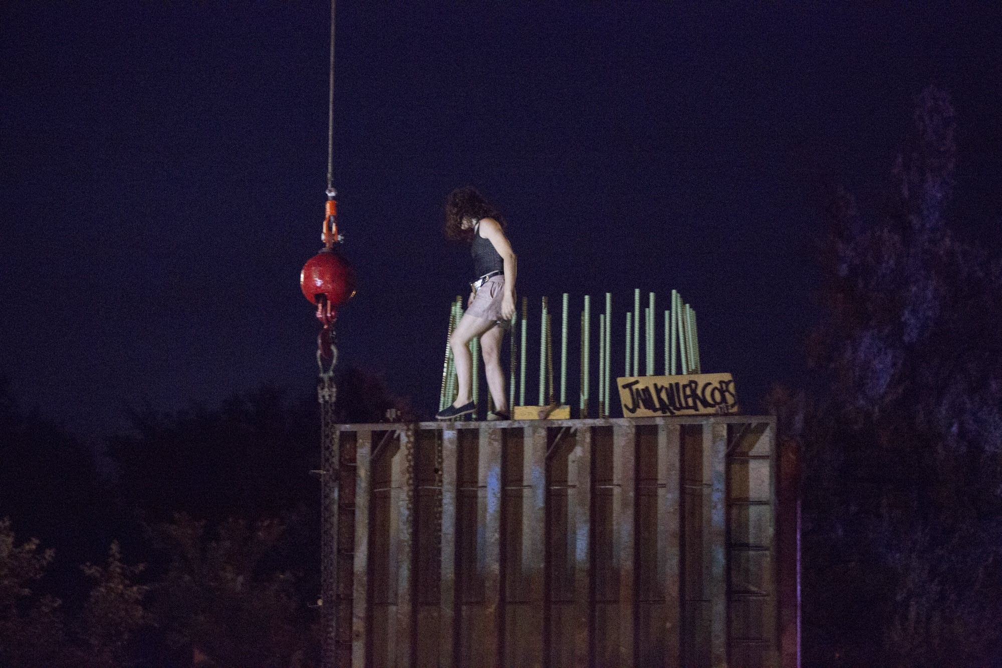 A protester climbs a construction project.