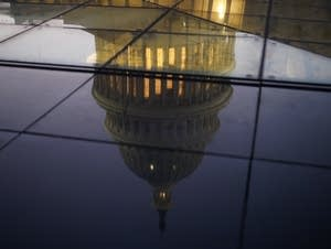 The U.S. Capitol, reflected in the windows of the Capitol Visitors Center.