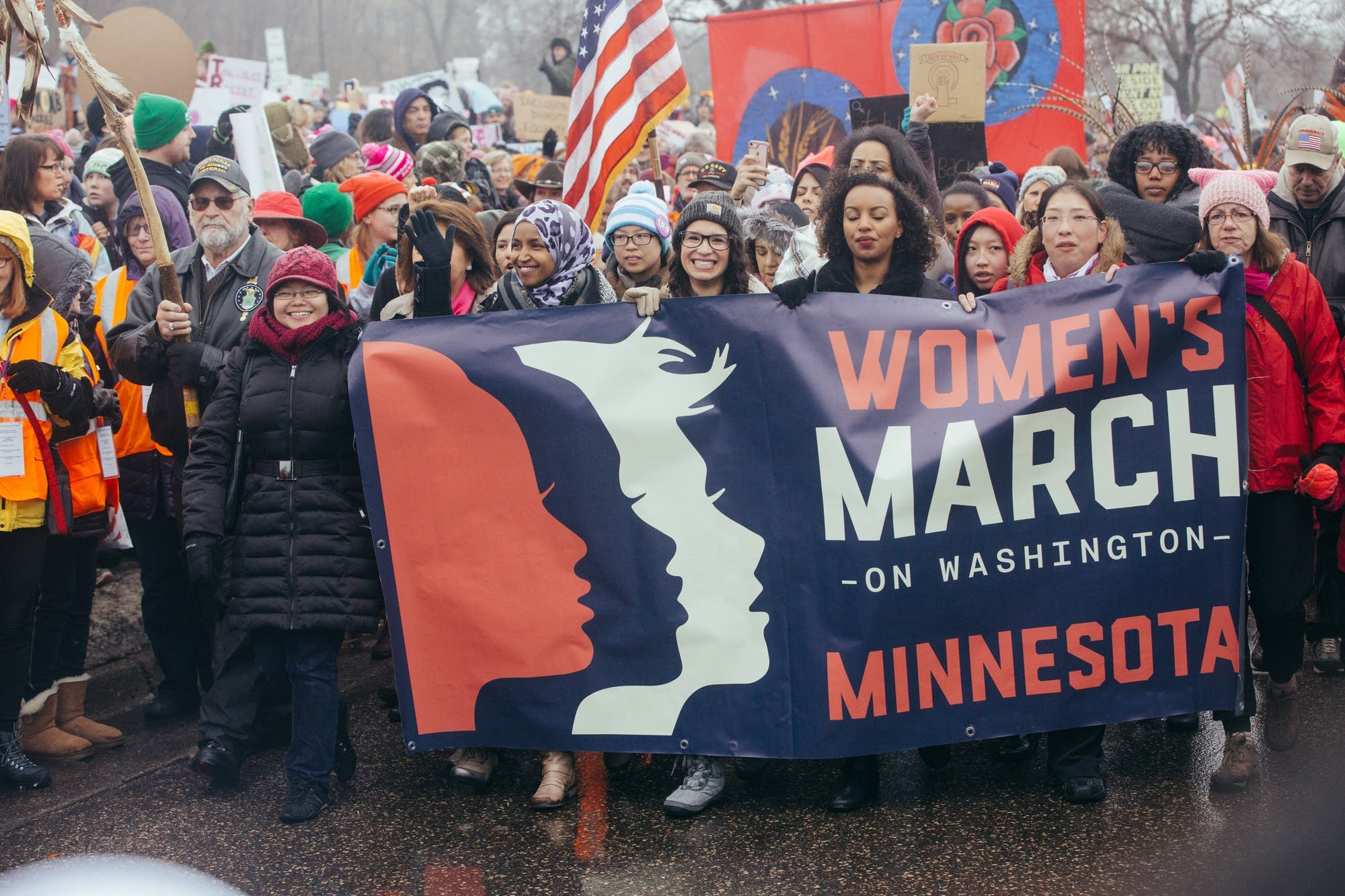 Ilhan Omar and other women lead the march.