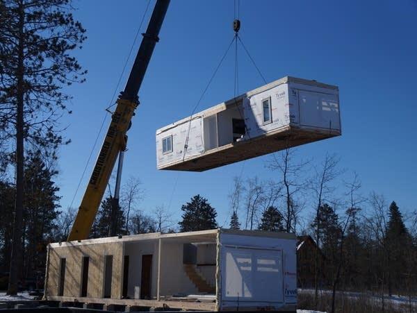 A modular home is being built.