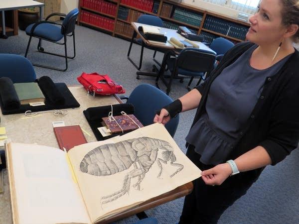 Curator Emily Beck shows a rare text.