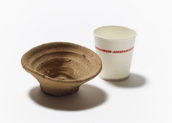 A 3,500-year-old disposable cup alongside a paper cup from the 1990s