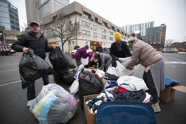Volunteers help pack donations.