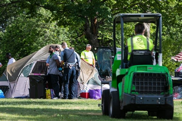 Squad is arrested by Minneapolis Park Police outside his tent.