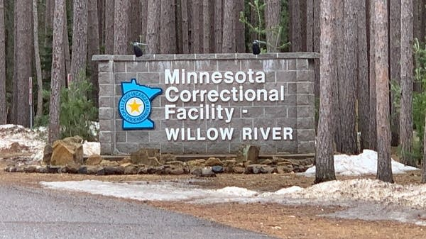 "A sign says ""Minnesota Correctional Facility - Willow River"""