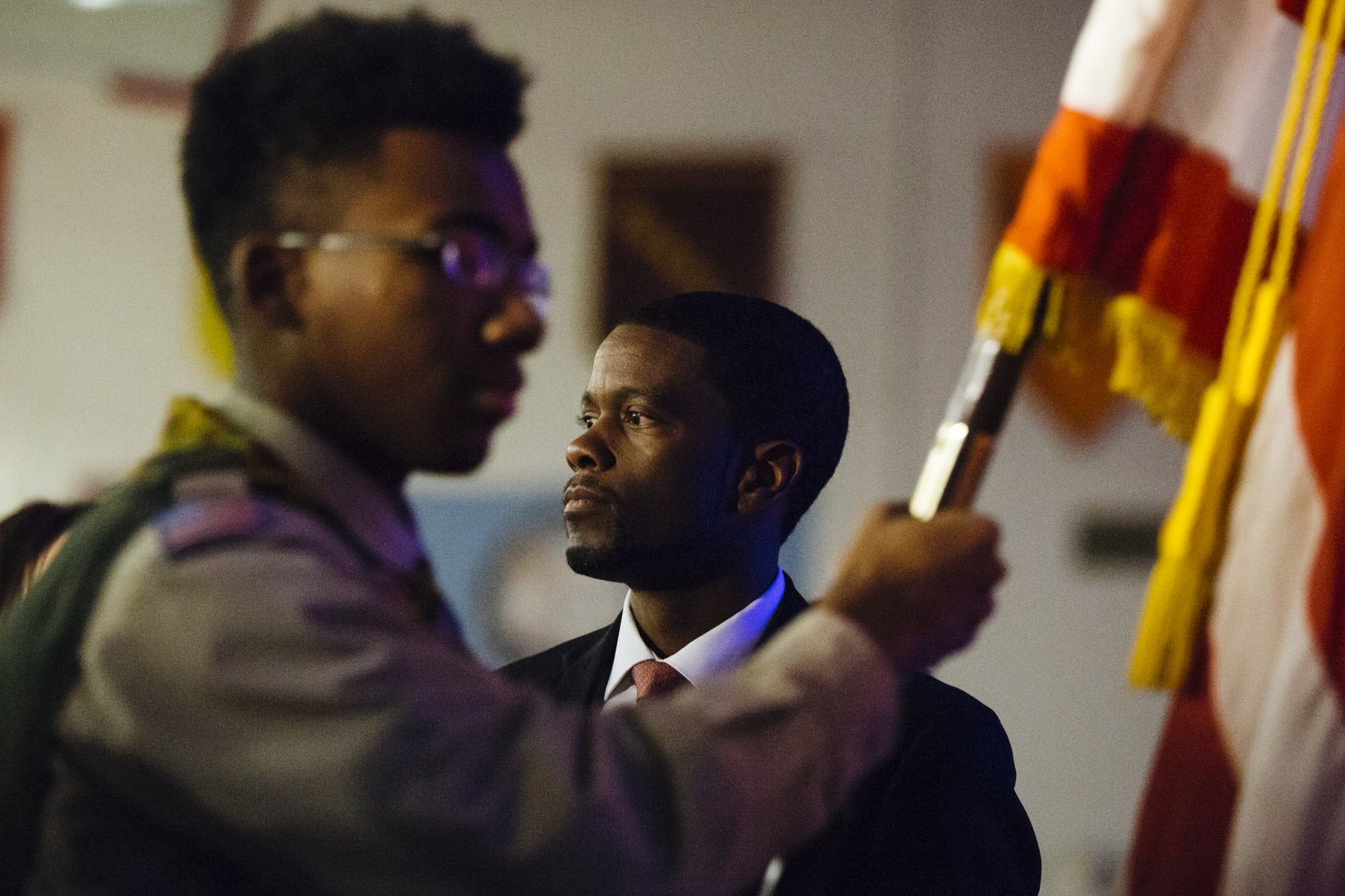 St. Paul Mayor Melvin Carter watches the color guard