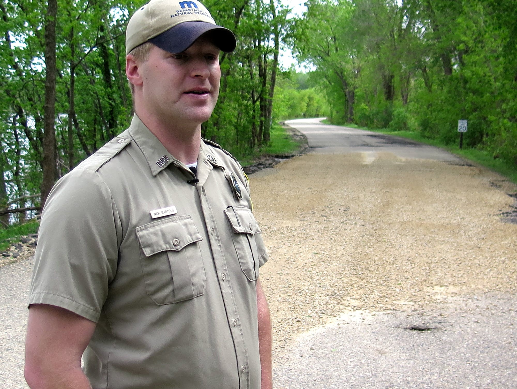 Nick Bartels stands in front of a gravel repair made to the park's road.