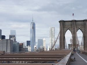 A view of New York City from the Brooklyn Bridge.