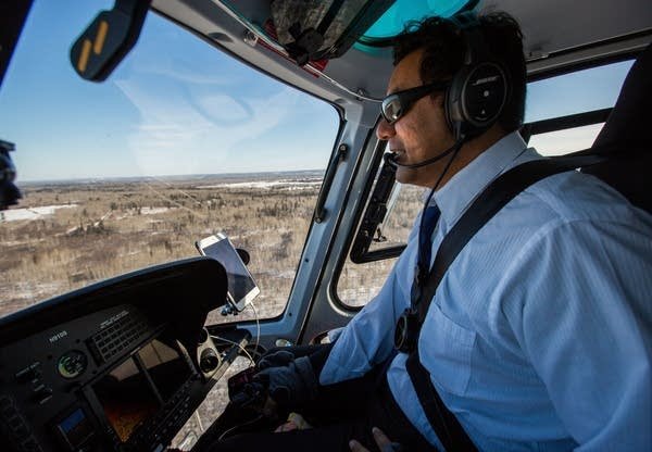 Helicopter pilot David Vargas regularly flies the route of Enbridge Line 3.