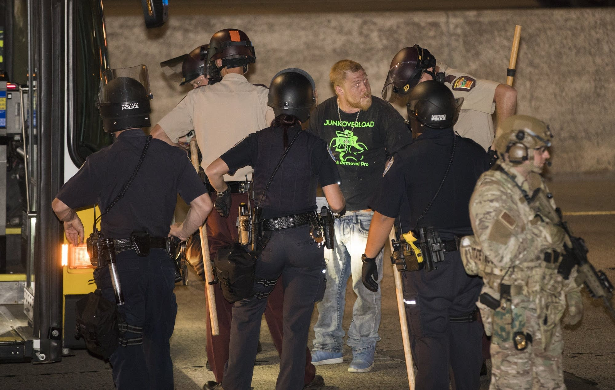 Police arrest a protester after a march on Interstate 94.